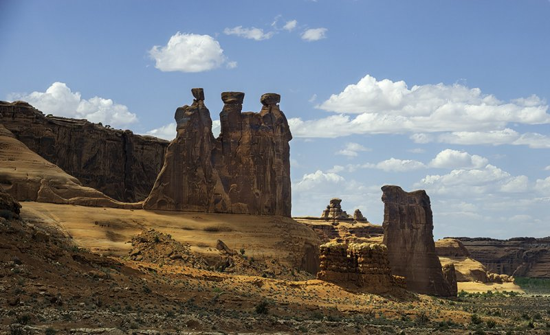 Three-Gossips-with-Sheep-Rock-looking-on
