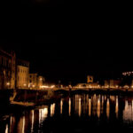 Lights reflected in River Arno, Florence Italy