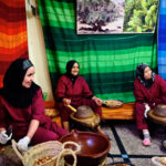 Three Women working to obtain Argan oil